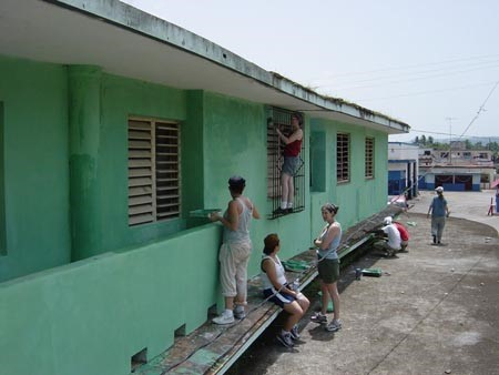 Painting a health clinic in Caimito